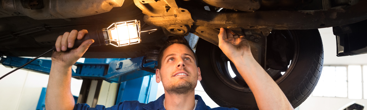 Mechanics doing an MOT test on a vehicle - MOT Derby